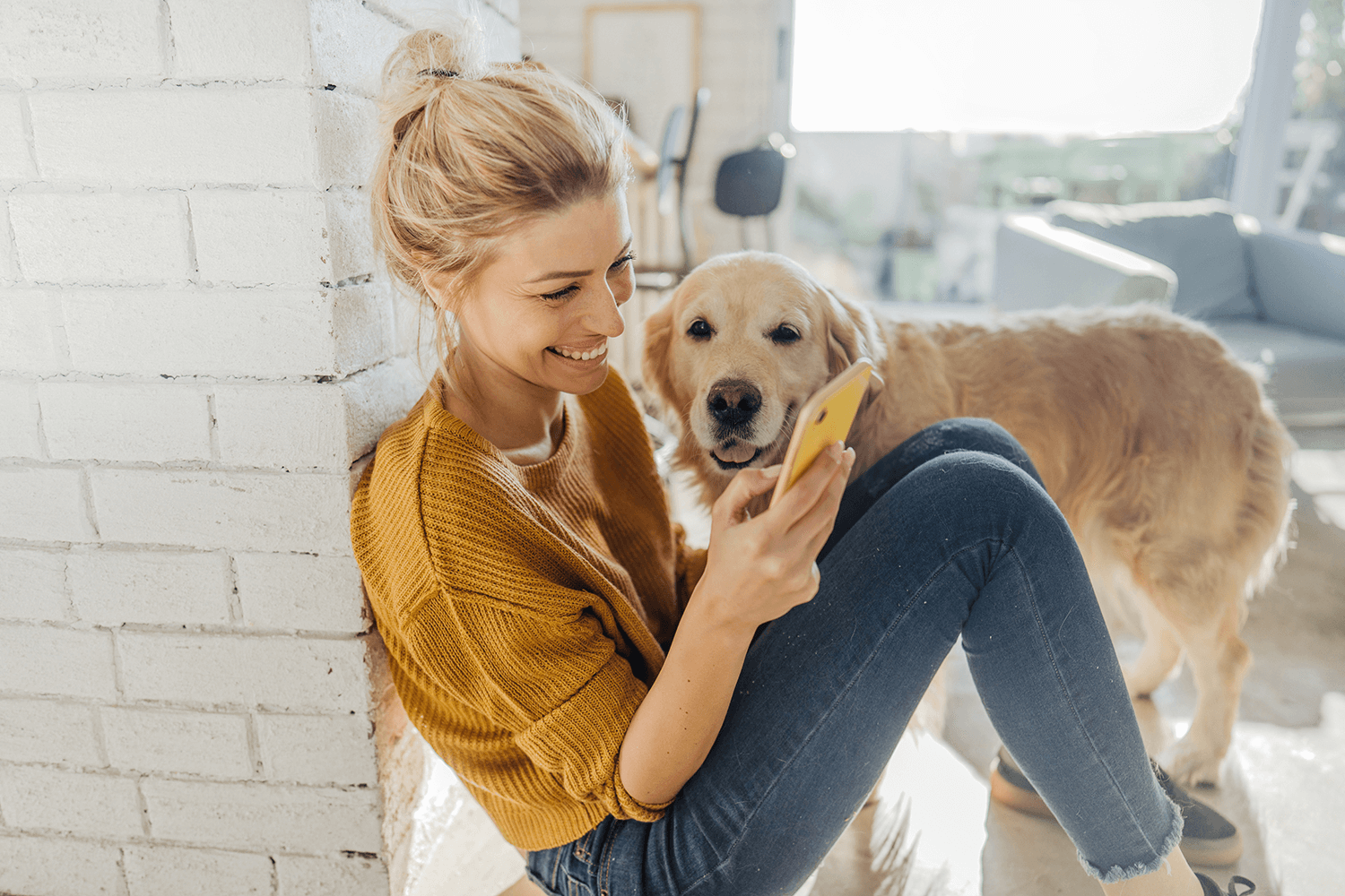 woman on the phone with a golden retriever