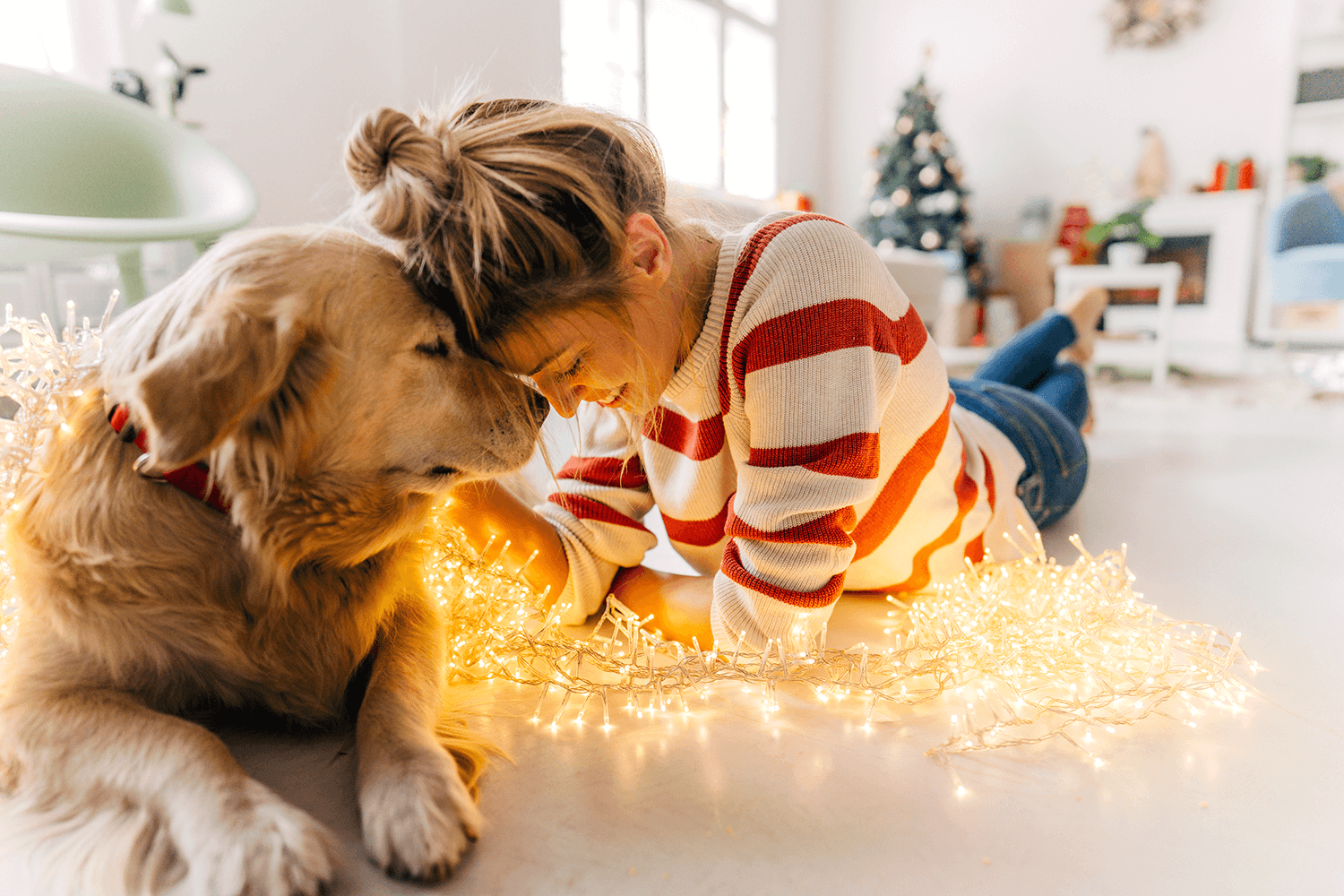 woman with her dog during the holidays